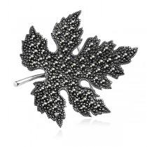 Broszka srebrna liść zdobiony Markazytami
